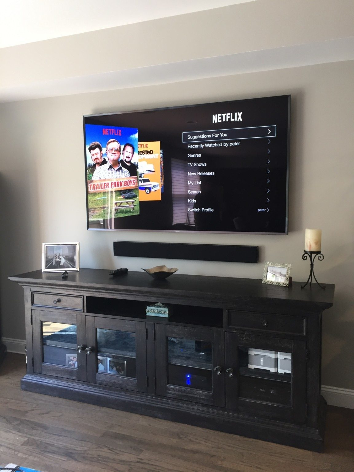 Large Samsung TV Wall Mounted With Sound Bar